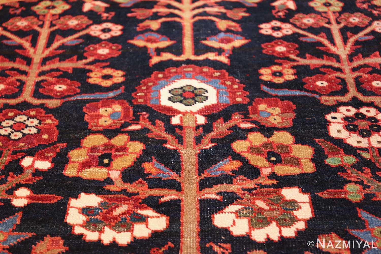 tree of life antique malayer persian rug 49527 slanted Nazmiyal