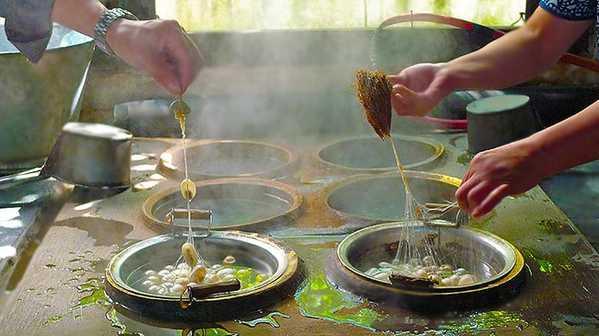 Harvesting and Unwinding Silk by Nazmiyal