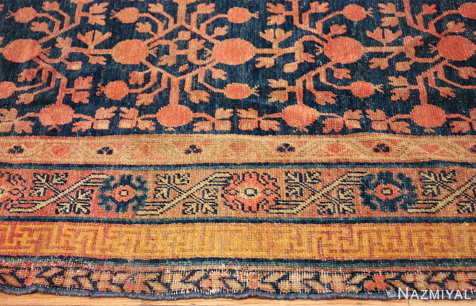 antique navy background pomegranate design khotan rug 49483 border Nazmiyal