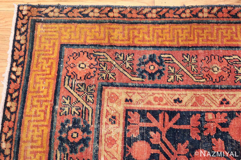 antique navy background pomegranate design khotan rug 49483 corner Nazmiyal