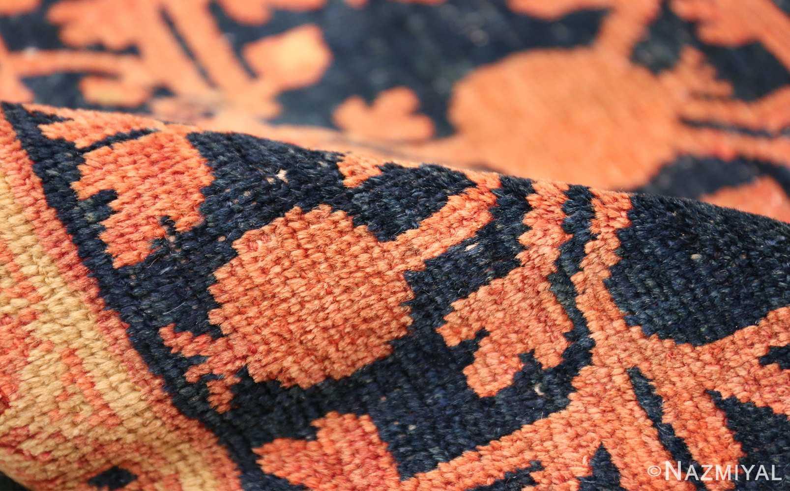 antique navy background pomegranate design khotan rug 49483 pile Nazmiyal
