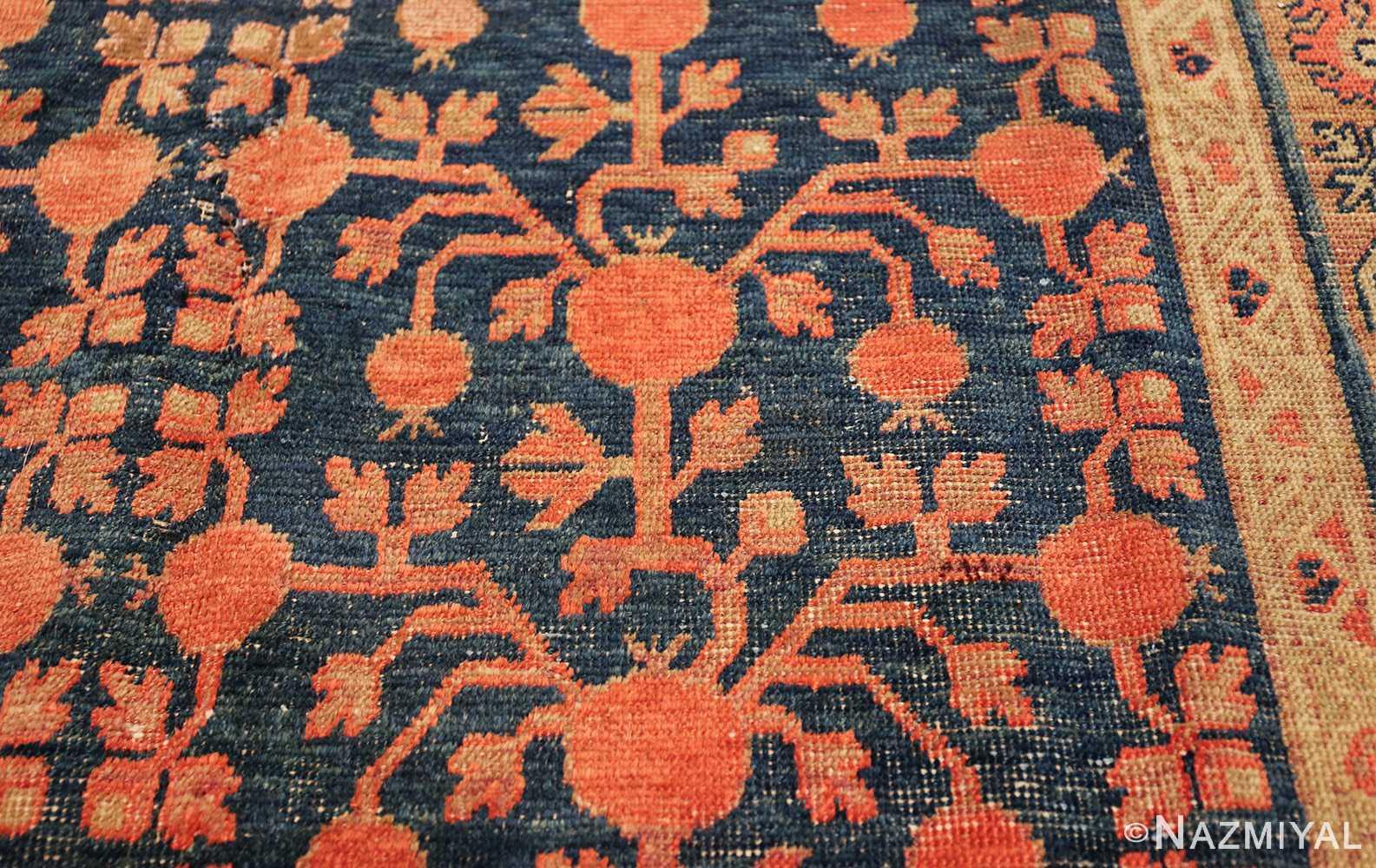 antique navy background pomegranate design khotan rug 49483 pomegranate Nazmiyal