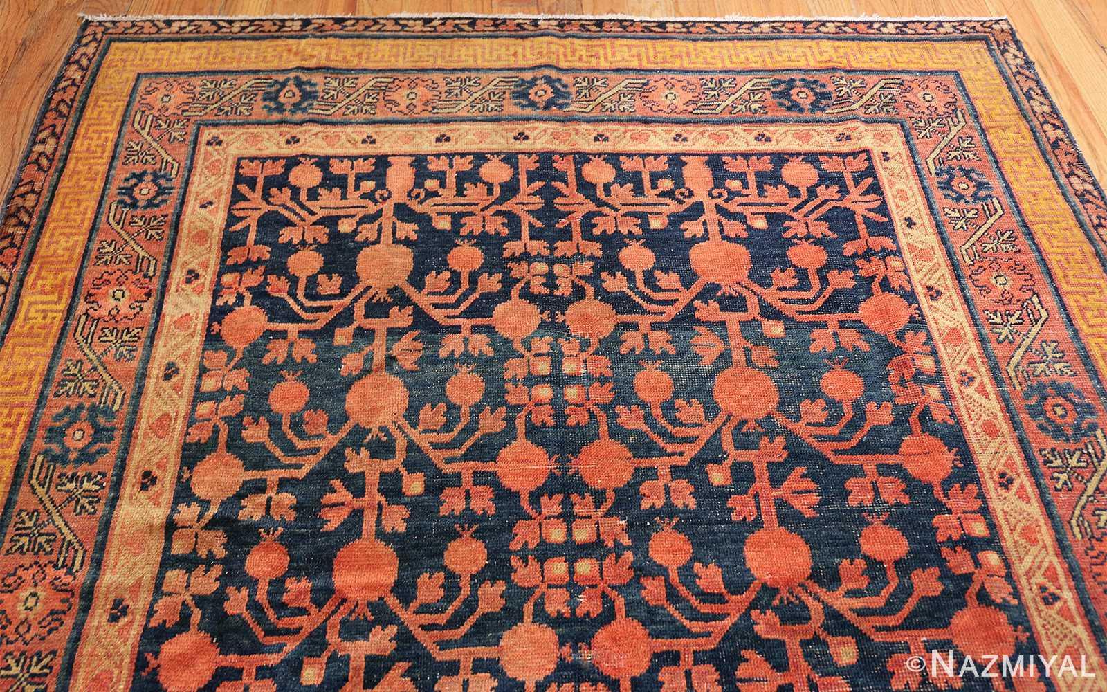 antique navy background pomegranate design khotan rug 49483 top Nazmiyal