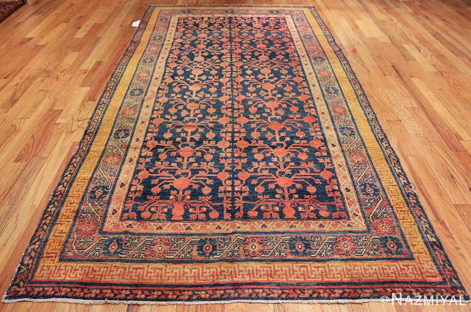 antique navy background pomegranate design khotan rug 49483 whole Nazmiyal