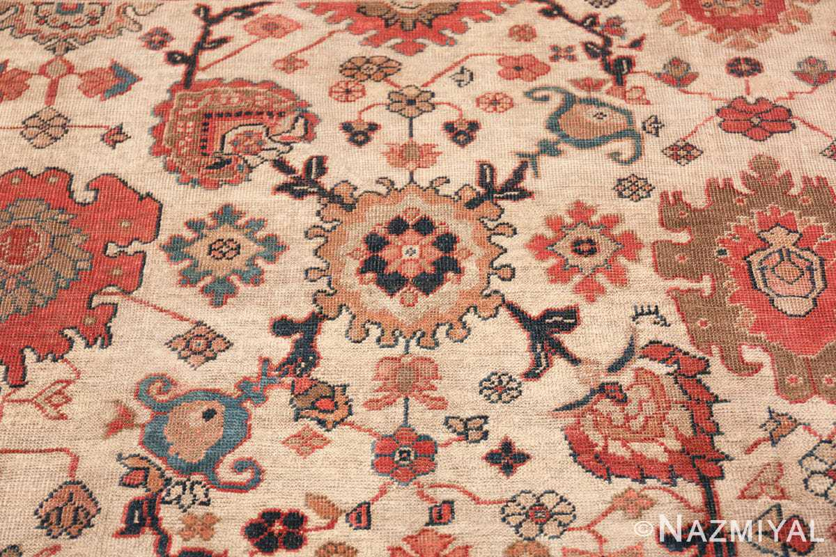ivory background antique sultanabad persian rug 49467 round Nazmiyal