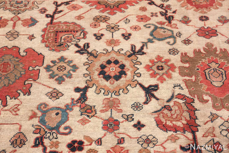 ivory background antique sultanabad persian rug 49467 round Nazmiyal