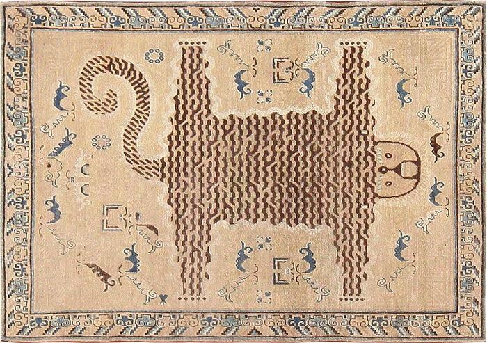 Antique Tribal design Khotan Carpet by nazmiyal