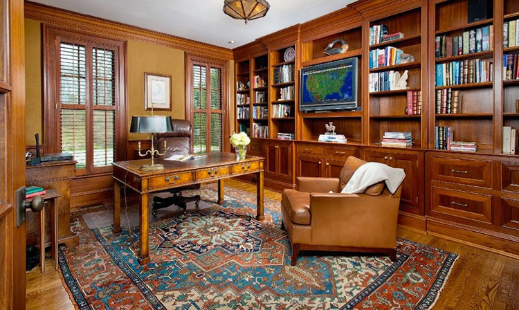 Library Decorated With An Antique Persian Heriz Rug by Nazmiyal