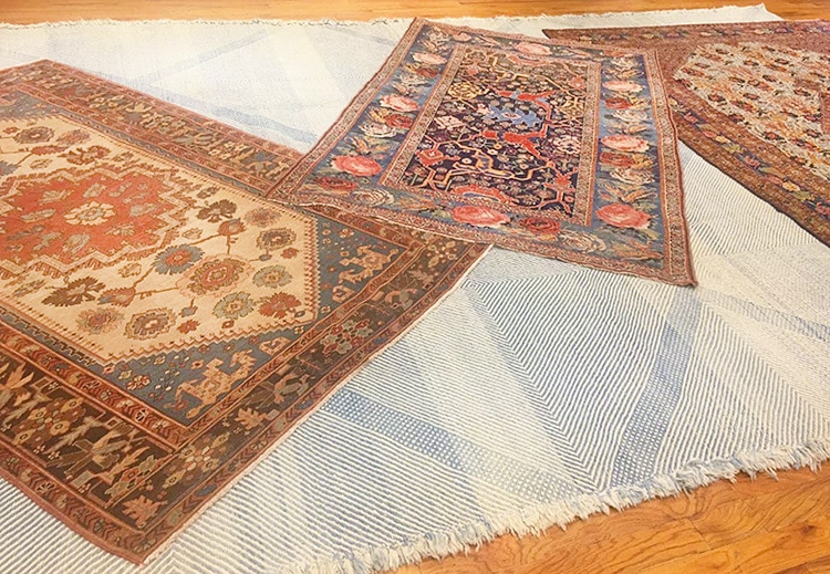Layering Persian Bohemian Rugs On top of other Persian rugs by Nazmiyal