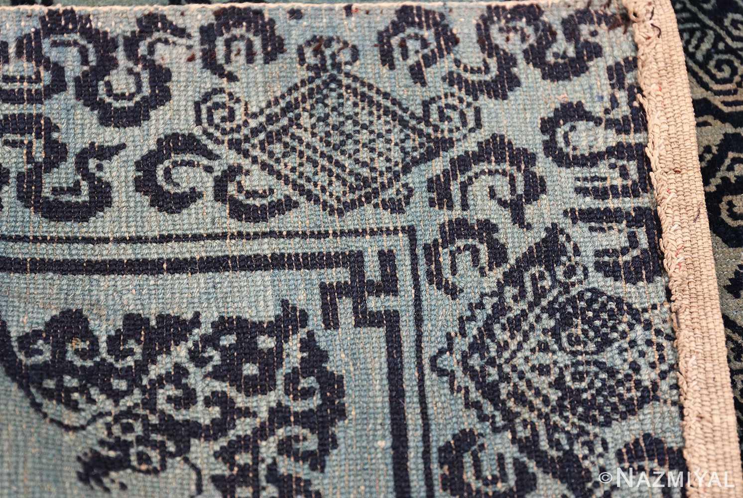 Antique Blue Background Tibetan Rug 49795 knots Nazmiyal