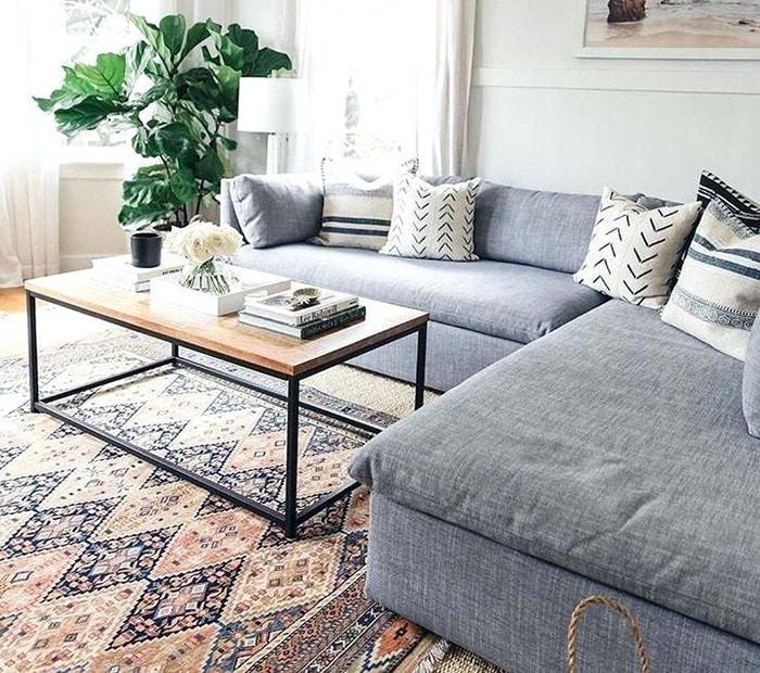 Grey Couch With Tribal Oriental Rug - Nazmiyal