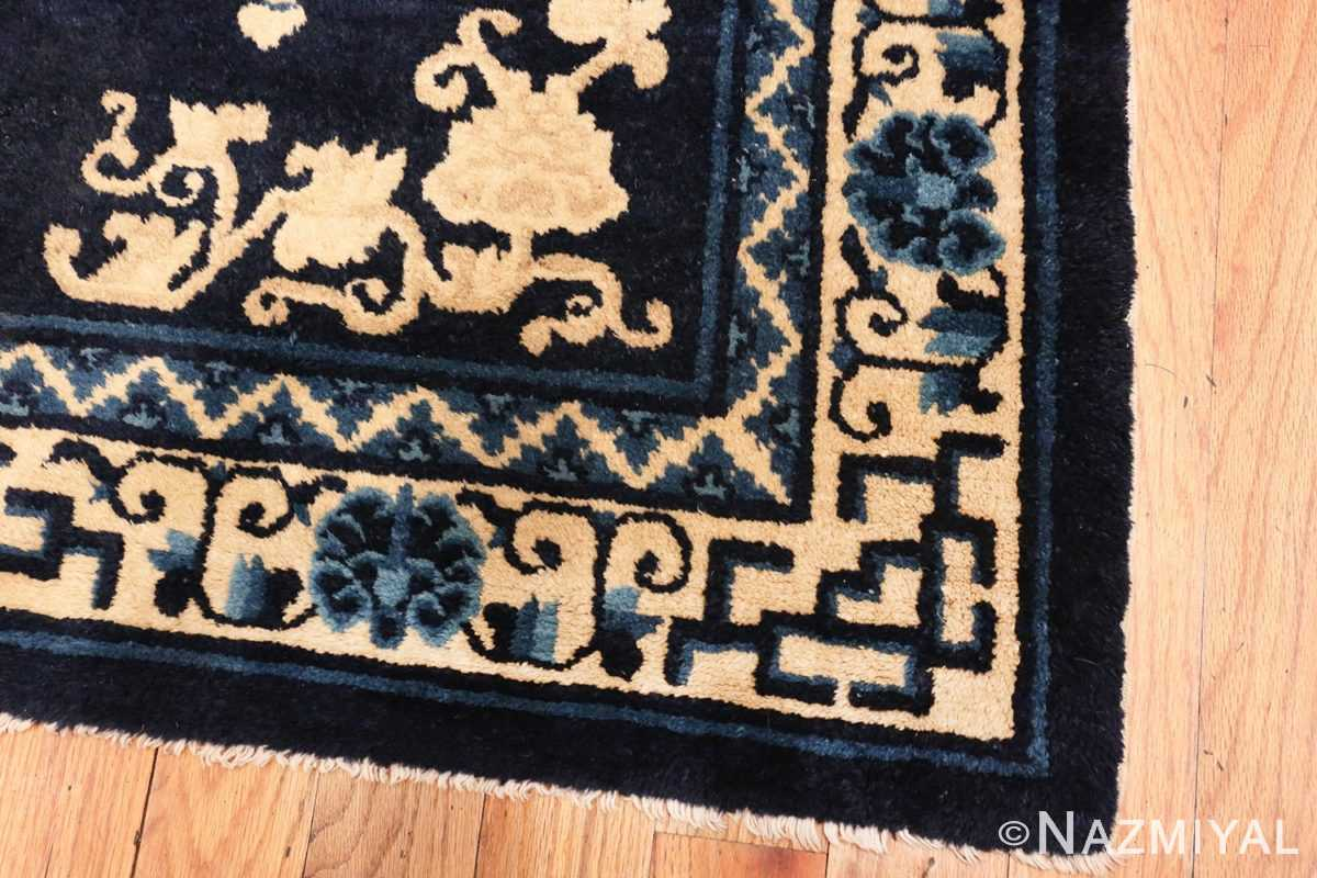 Image of Corner of Small Antique Peking Foo Dog Chinese Rug #70039 from the collection of Nazmiyal Antique Rugs NYC