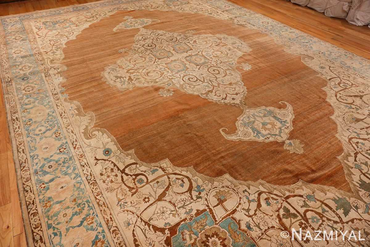An overall picture from the side of Large Antique Tabriz Persian Rug #48815 from Nazmiyal Antique Rugs in NYC