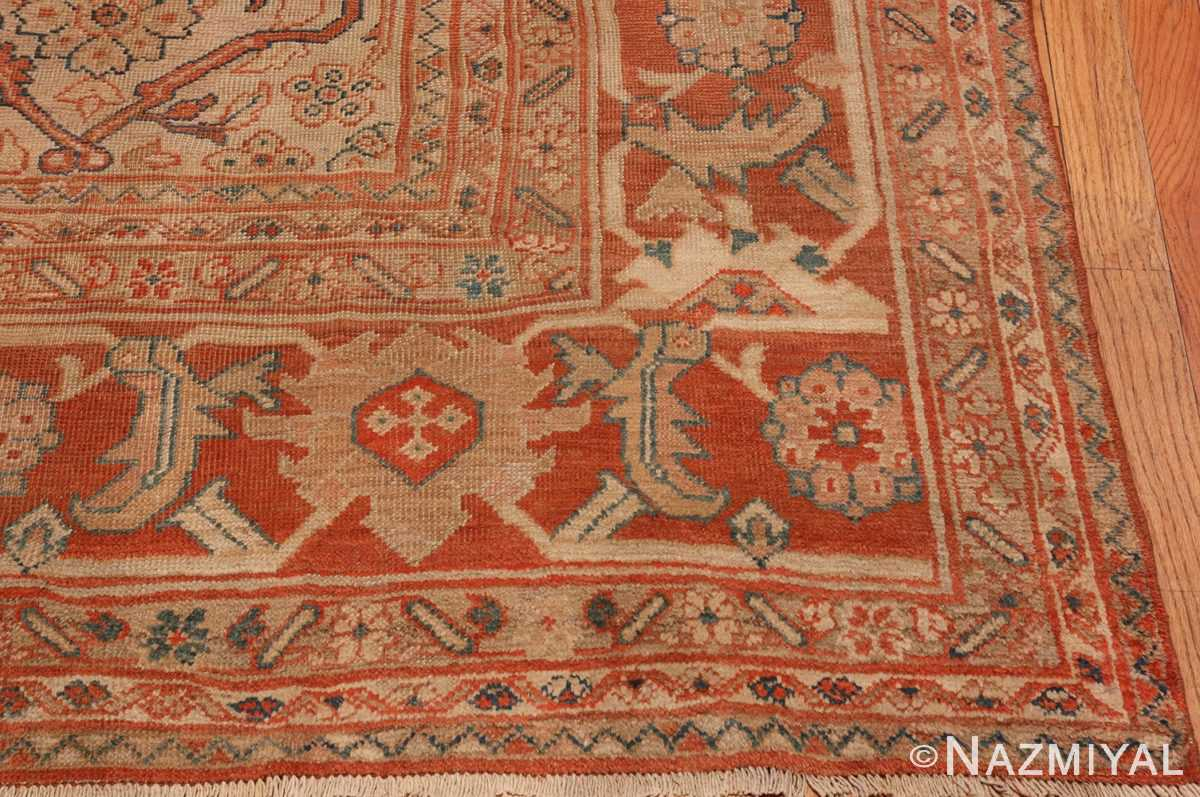 A picture of the corner of Antique Ivory Persian Sultanabad rug #50576 from Nazmiyal Antique Rugs in NYC