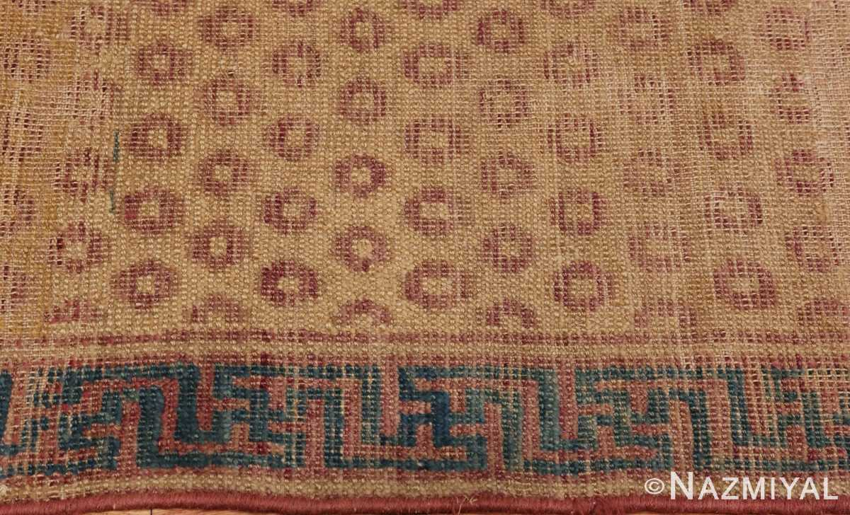 A picture of the border of Antique Shabby Chic Khotan Rug #49969 from Nazmiyal Antique Rugs in NYC