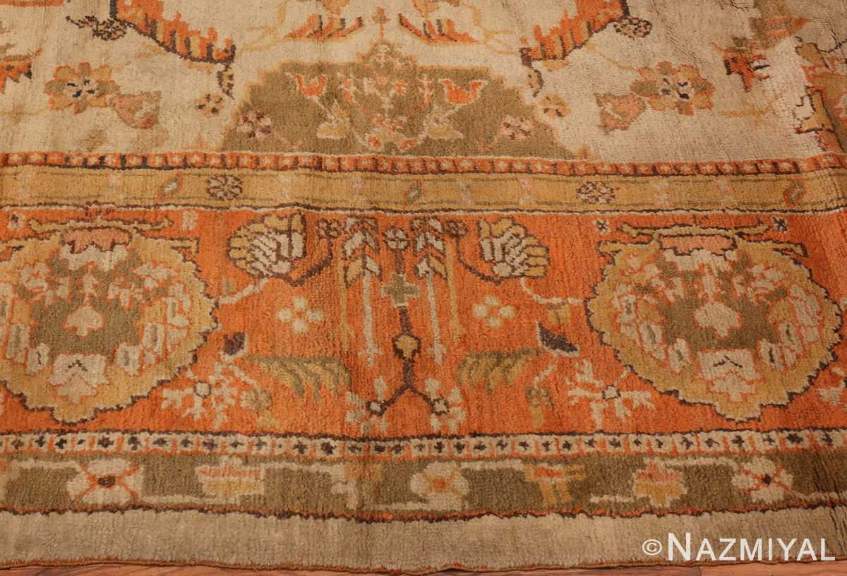 A Picture of the Border of Large Antique Turkish Oushak Rug #50674 from Nazmiyal Antique Rugs in NYC