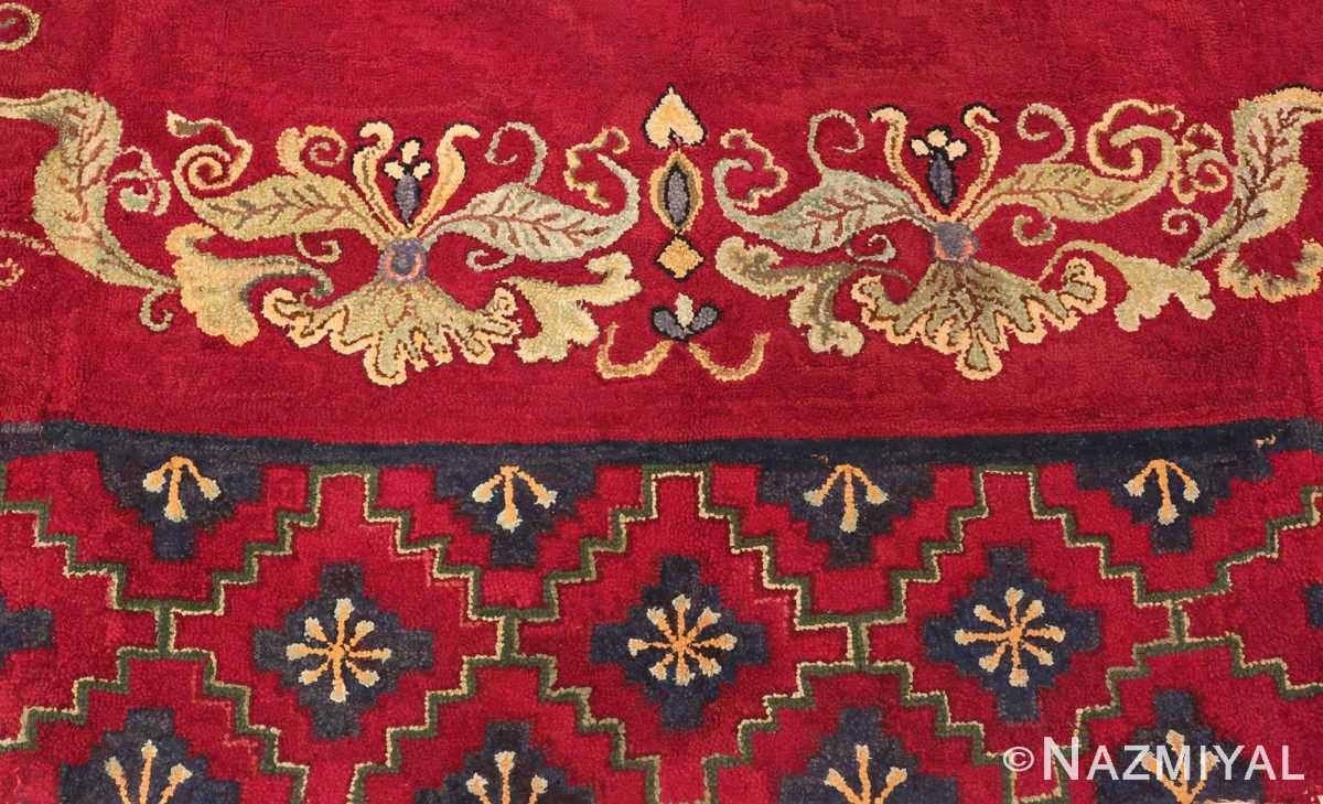 Picture of the border of the red Medallion Design Antique American Hooked Rug #70059 from Nazmiyal Antique Rugs in NYC