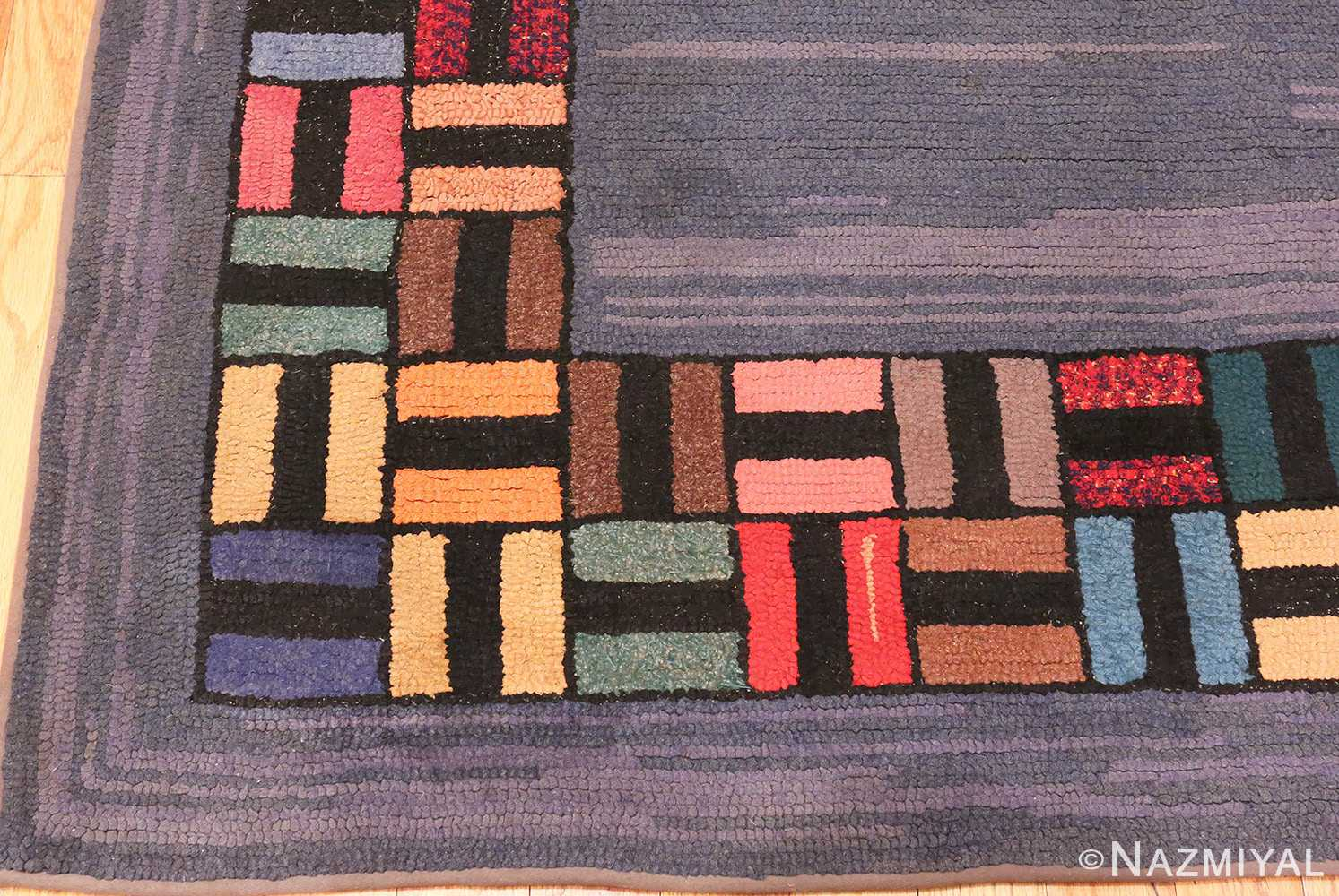 Picture of the corner of Light Blue Antique American Hooked Rug #70057 from Nazmiyal Antique Rugs in NYC