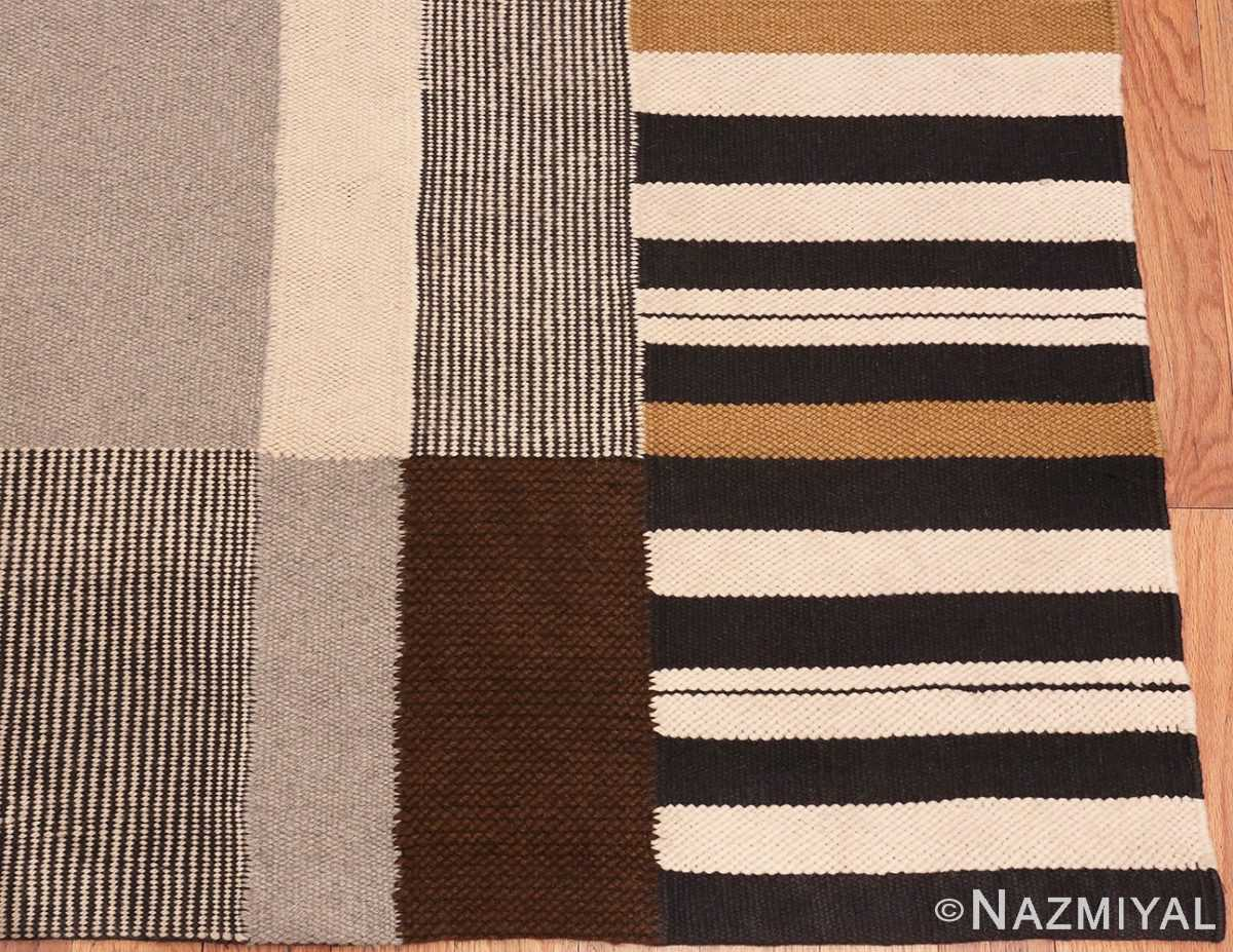 Picture of the corner of Alice Kagawa Parrott Art Kilim #70026 From Nazmiyal Antique Rugs in NYC