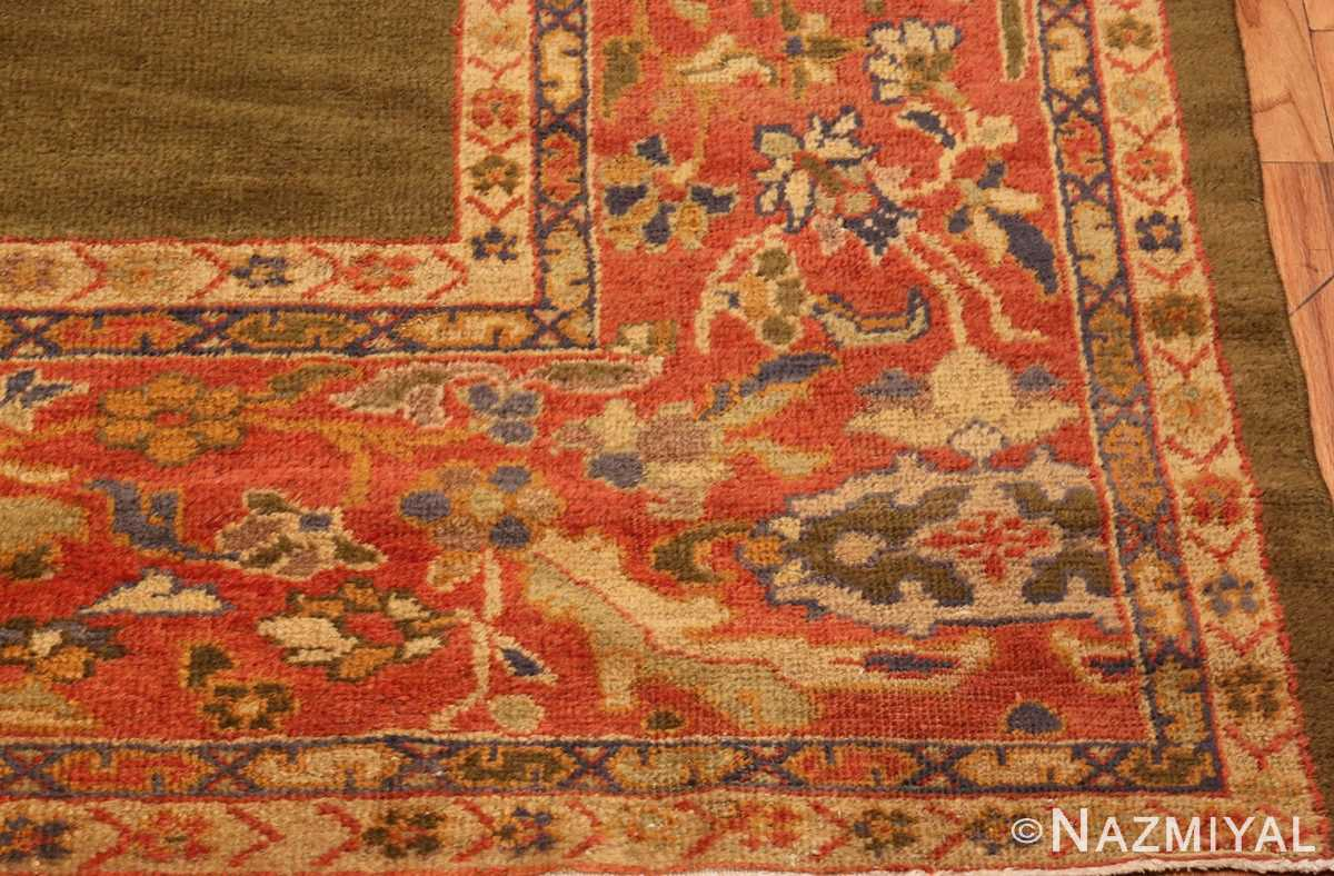 Picture of the corner of Antique Green Persian Sultanabad Rug #50335 From Nazmiyal Antique Rugs In NYC