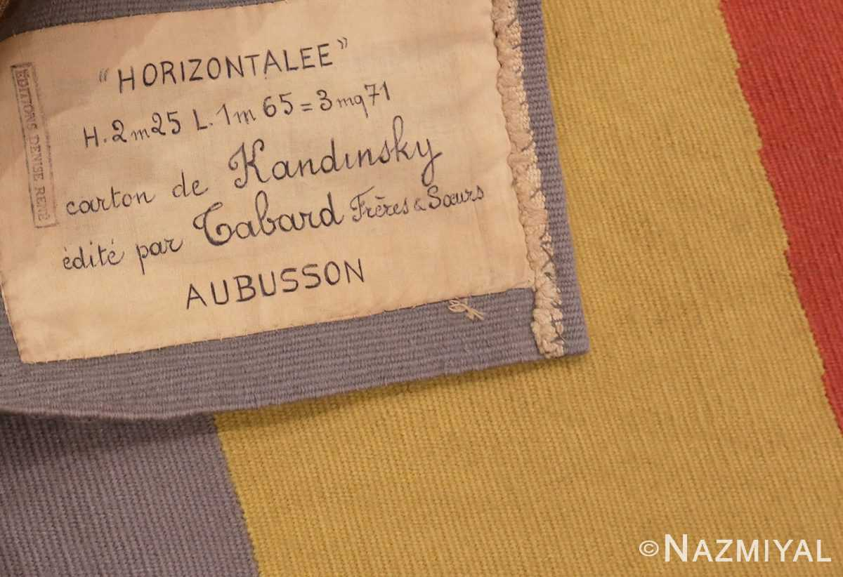 Picture of the Label of French Bauhaus Wassily Kandinsky Tapestry 41278 From Nazmiyal Antique Rugs in NYC
