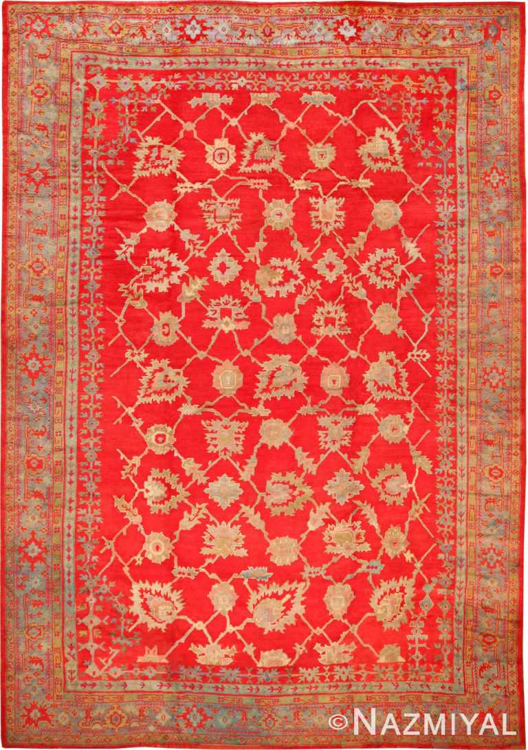 Picture of the Large Size All Over Design Rich Red Color Background Antique Turkish Oushak Rug #70012 from Nazmiyal Antique Rugs in NYC.