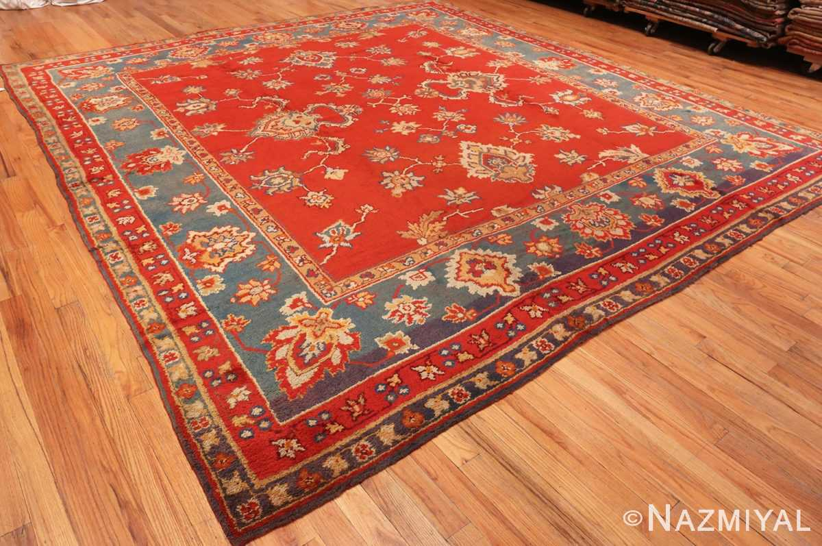 Overall Picture from the Side Of Square Size Antique Irish Donegal Rug #3328 From Nazmiyal Antique Rugs In NYC