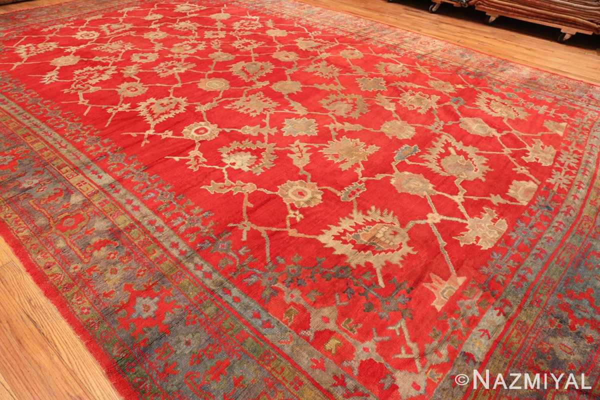 A Side Picture Of Large Red Antique Turkish Oushak Rug #70012 From Nazmiyal Antique Rugs in NYC