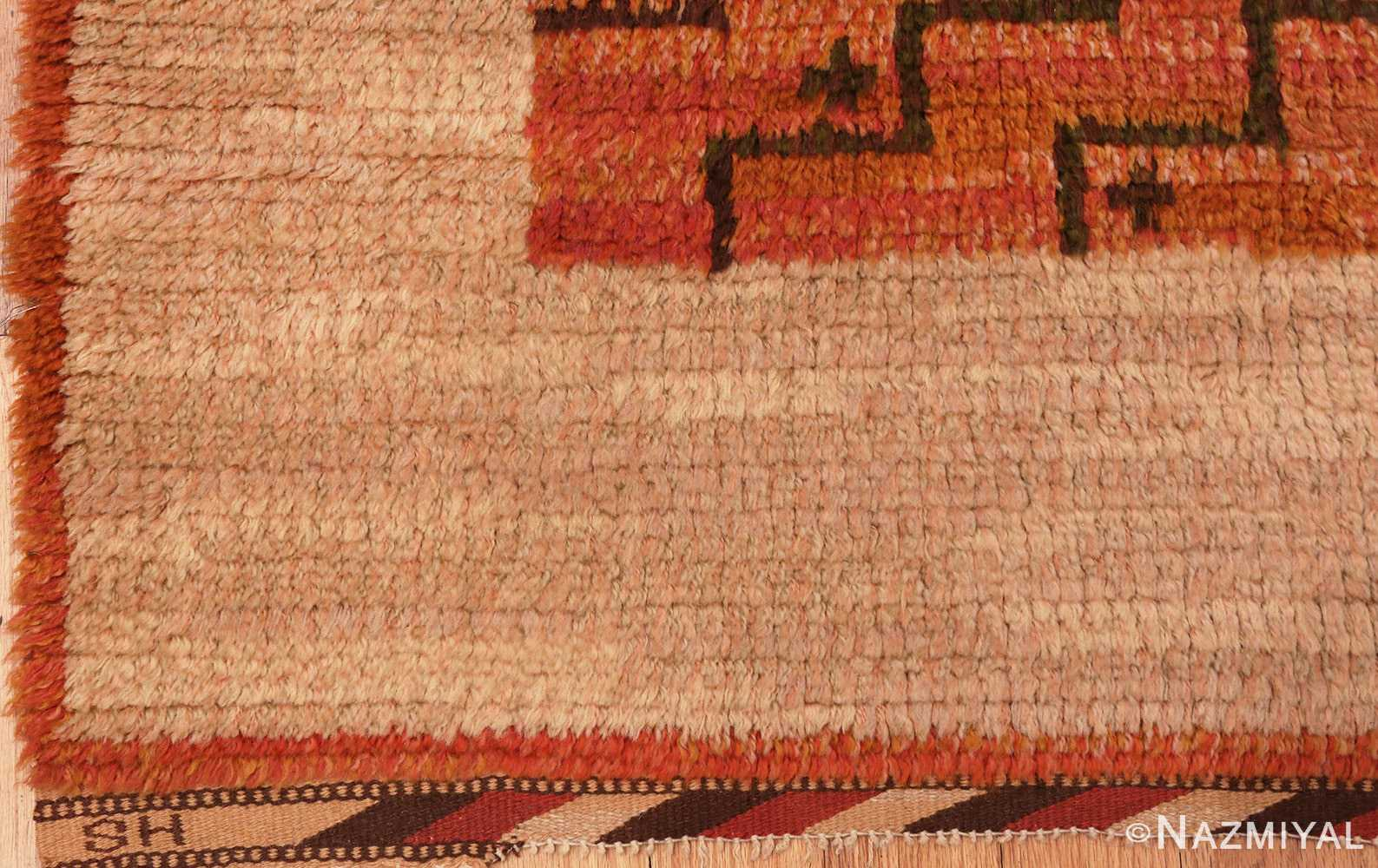 Picture of the signature of the square vintage Scandinavian Swedish Rug #40294 from Nazmiyal Antique Rugs in NYC