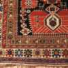A corner picture of antique Caucasian Shirvan rug #70076 from Nazmiyal Antique Rugs in NYC