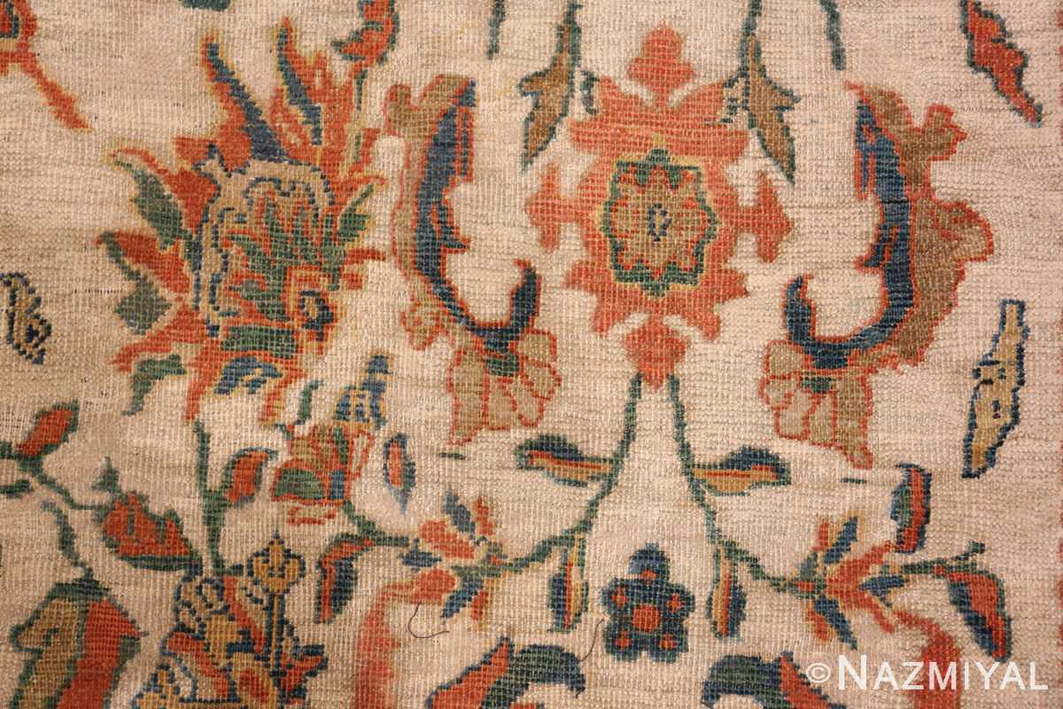 A detailed animal picture of the large ivory background antique persian sultanabad rug #50571 from Nazmiyal Antique Rugs NYC