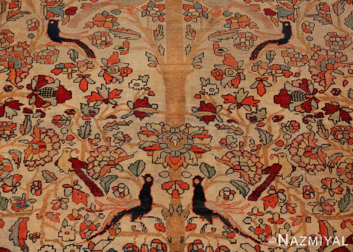 A detailed picture of the antique tree of life persian mohtashem kashan rug #70069 from Nazmiyal Antique Rugs NYC