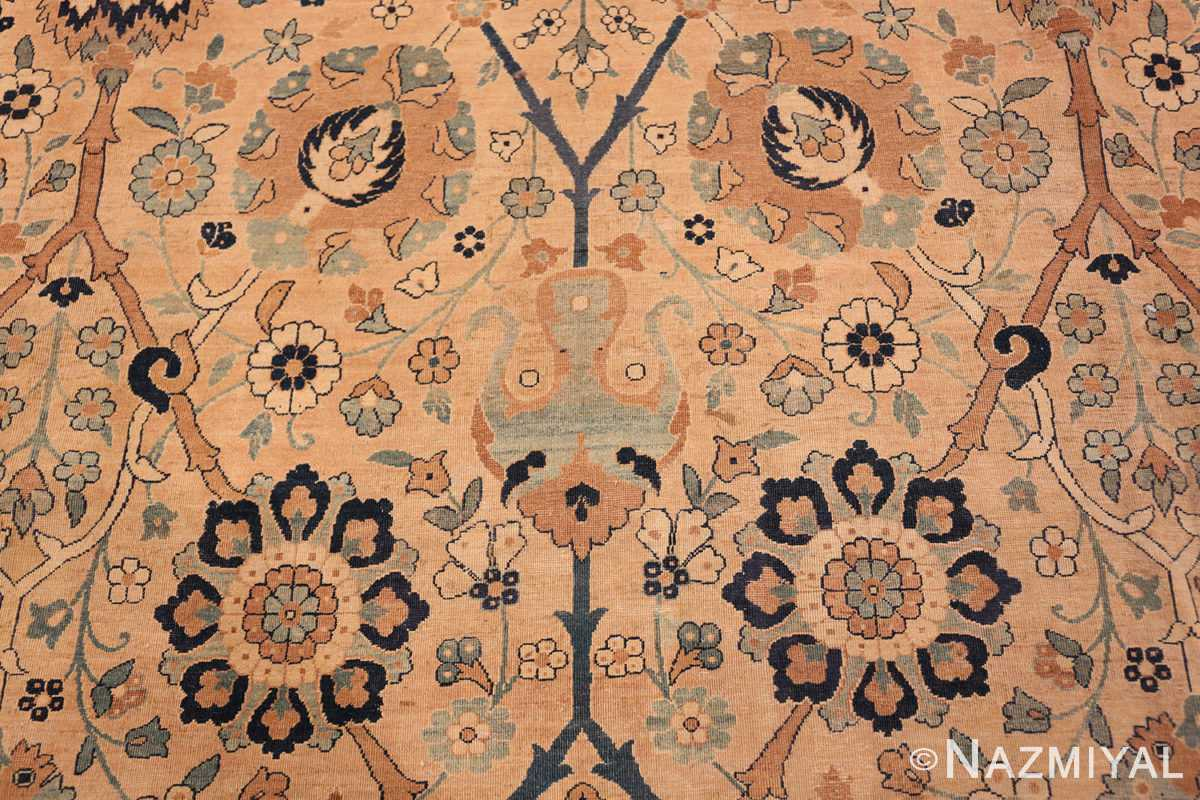 A detail blue flower picture of the large vase design antique persian kerman rug #50701 from Nazmiyal Antique Rugs NYC