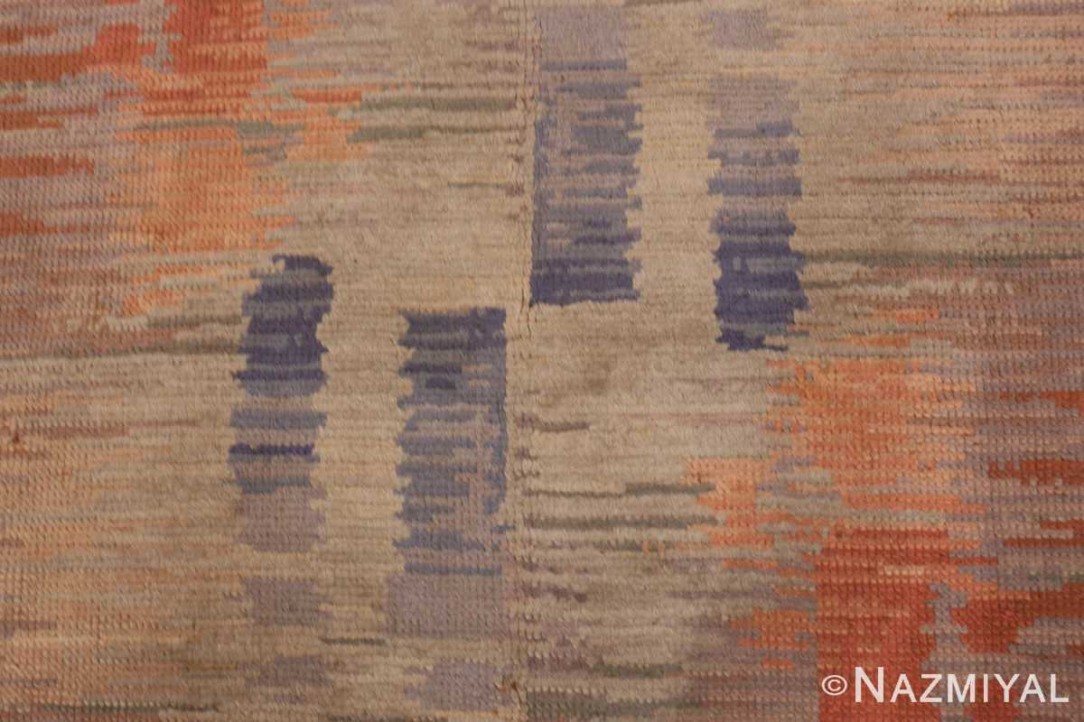 A detail blue pattern picture of the vintage surrealist french art deco rug #50737 from Nazmiyal Antique Rugs NYC