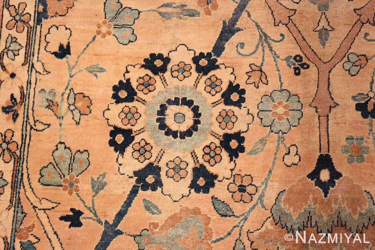 A detailed picture of center flower of the large vase design antique persian kerman rug #50701 from Nazmiyal Antique Rugs NYC