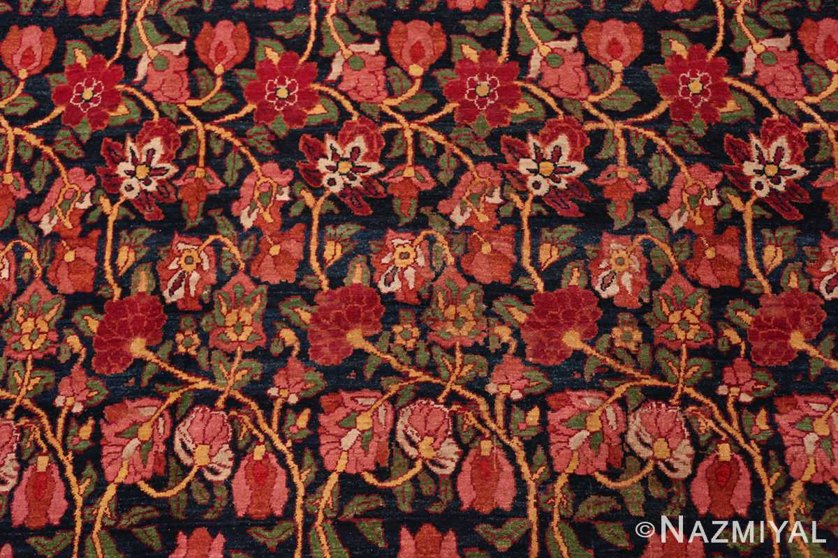 A detailed flower picture of antique blue background persian bidjar carpet #47411 from Nazmiyal Antique Rugs NYC