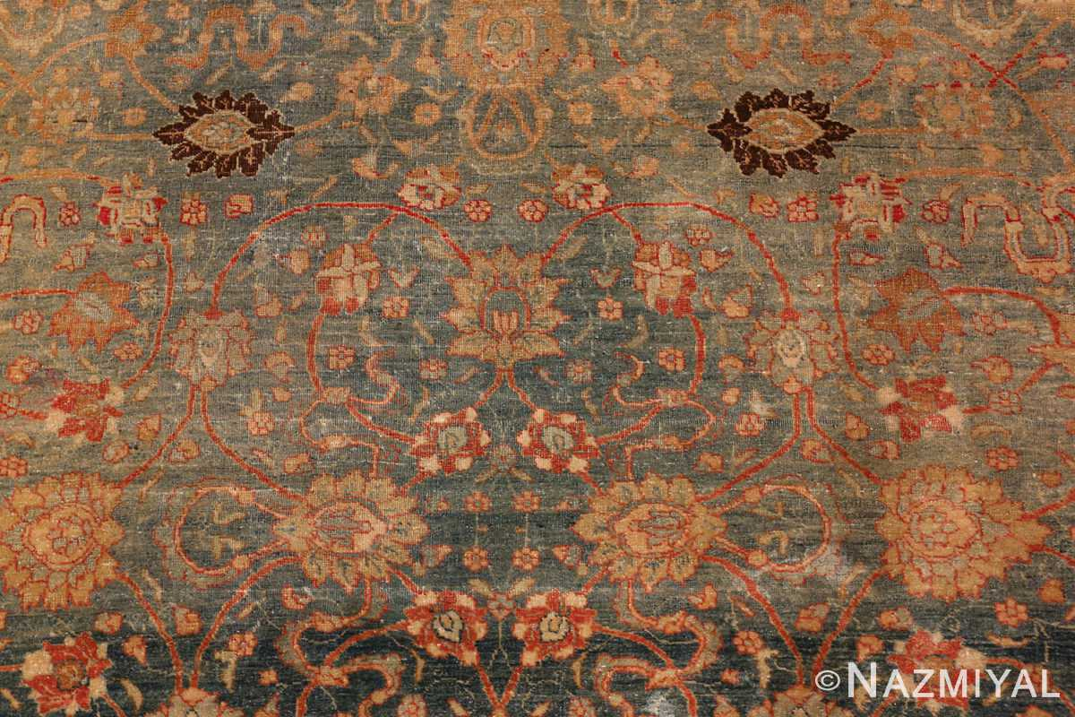 A detail flower picture of the antique persian tabriz #70070 from nazmiyal new york city