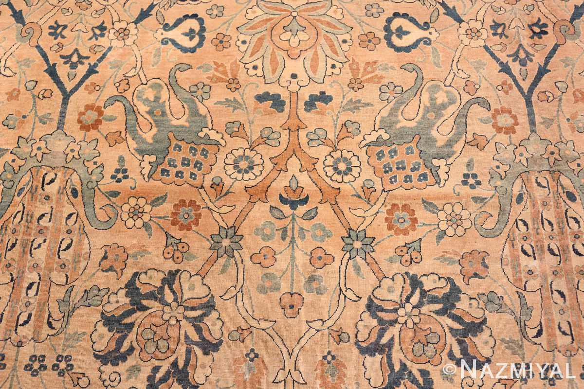 A detailed piture of flower of center flower of the large vase design antique persian kerman rug #50701 from Nazmiyal Antique Rugs NYC