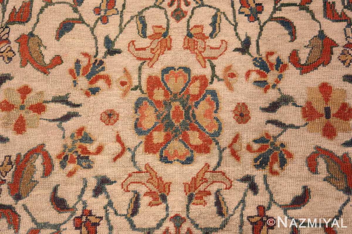 A detailed red flower picture of the large ivory background antique persian sultanabad rug #50571 from Nazmiyal Antique Rugs NYC