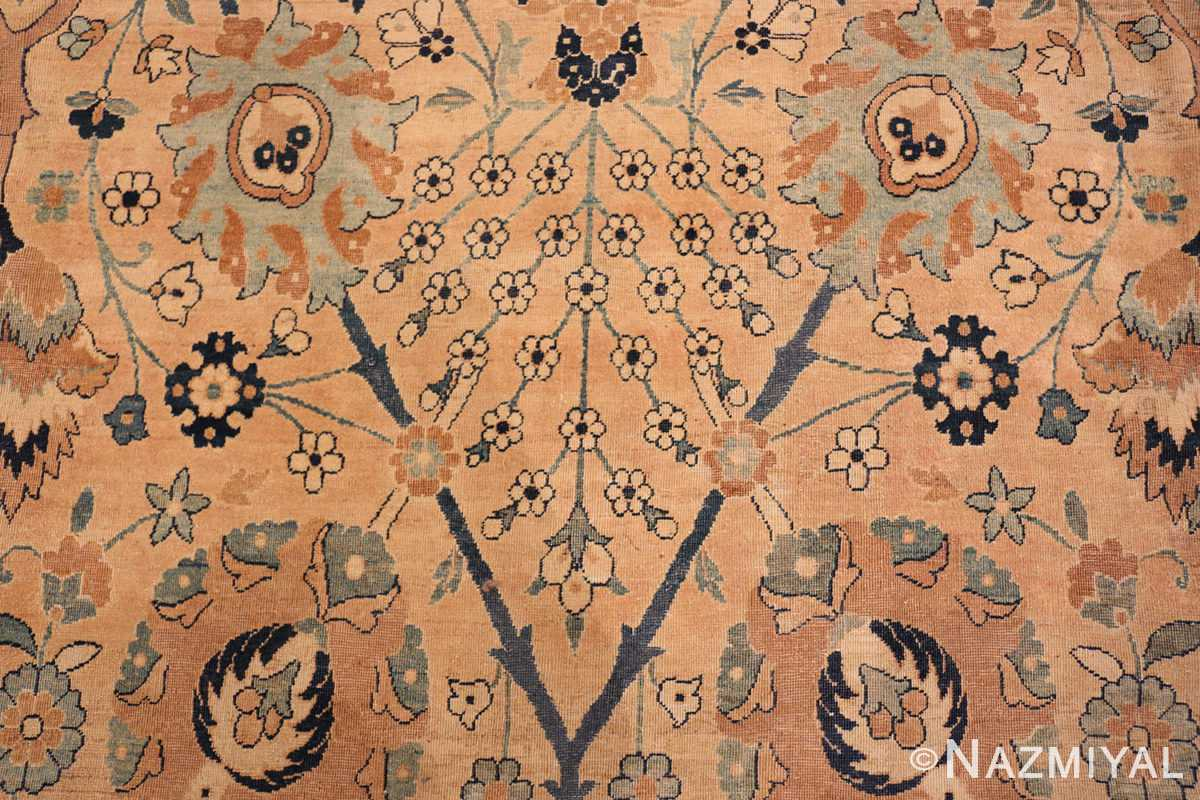 A detailed small flower picture of the large vase design antique persian kerman rug #50701 from Nazmiyal Antique Rugs NYC