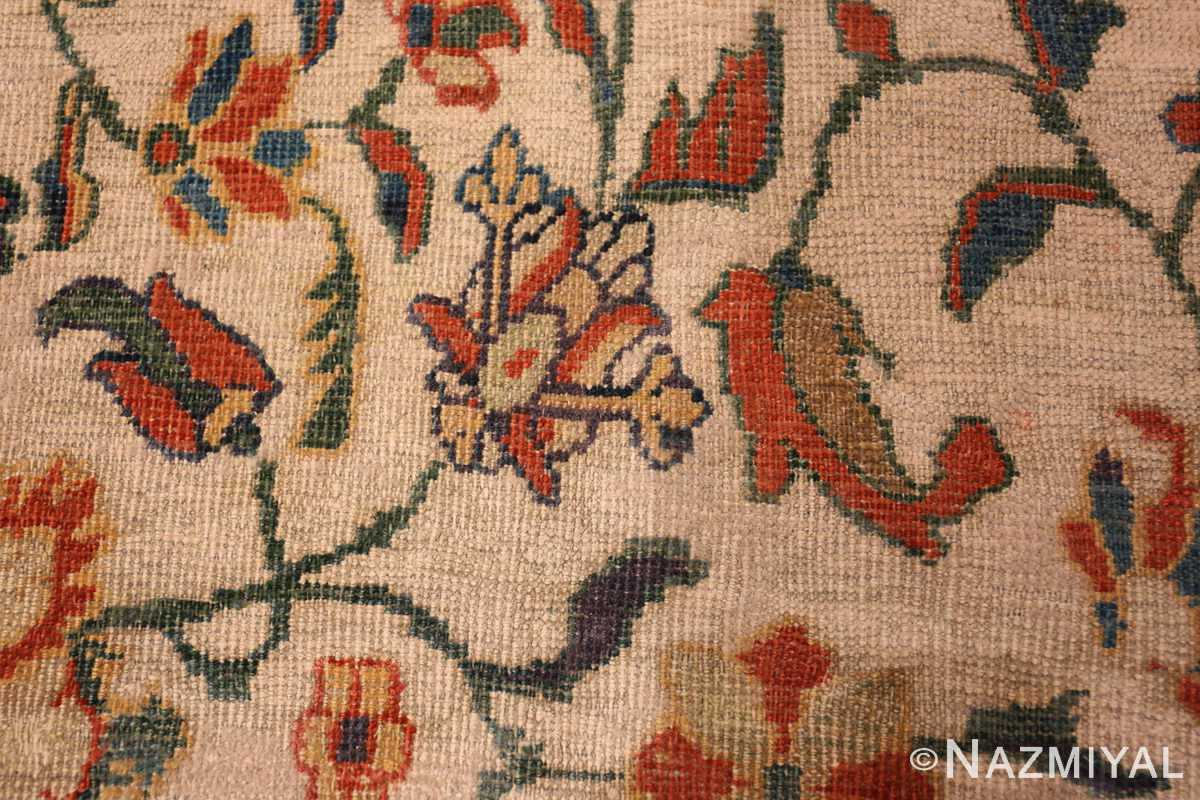 A detailed yellow flower picture of the large ivory background antique persian sultanabad rug #50571 from Nazmiyal Antique Rugs NYC