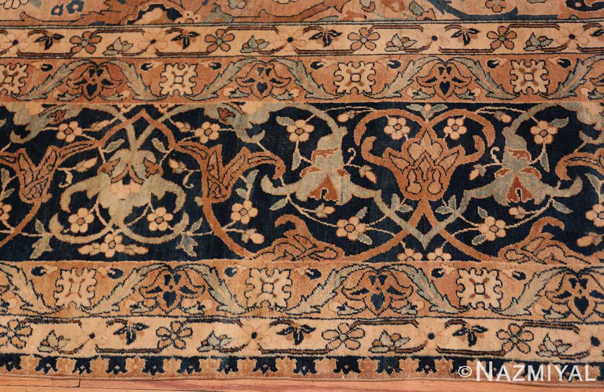 An edge picture of the large vase design antique persian kerman rug #50701 from Nazmiyal Antique Rugs NYC