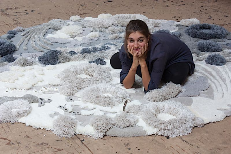 Environmental Activist and Textile Artist Vanessa Barragao with her art work - Nazmiyal Antique Rugs